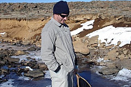 Searching for frogs in a frozen stream Lesotho